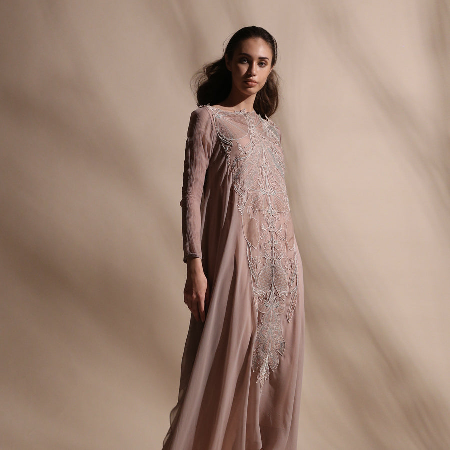 Layered kurta dress gracefully draped in bias cut chiffon is offered with a stretch net pants. Dress is embellished with forest pattern delicate thread and pearl embroidery. abhishek sharma, abhishekstudio
