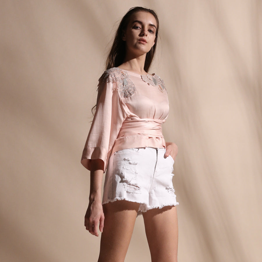 Crafted in fluid fabrics, Abhishek Sharma's modern statement pieces pack in innovative drapery with fine Resham and sequin embroidery. It is a satin kimono crop top with knotted tie up at the waist.  Abhishek Sharma, abhishekstudio