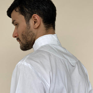 Hand sewn fluted collar shirt in super fine cotton. Sleeves are ornamented with very fine pin tuck lines till elbow opening up to armhole. abhishek sharma, abhishek studio