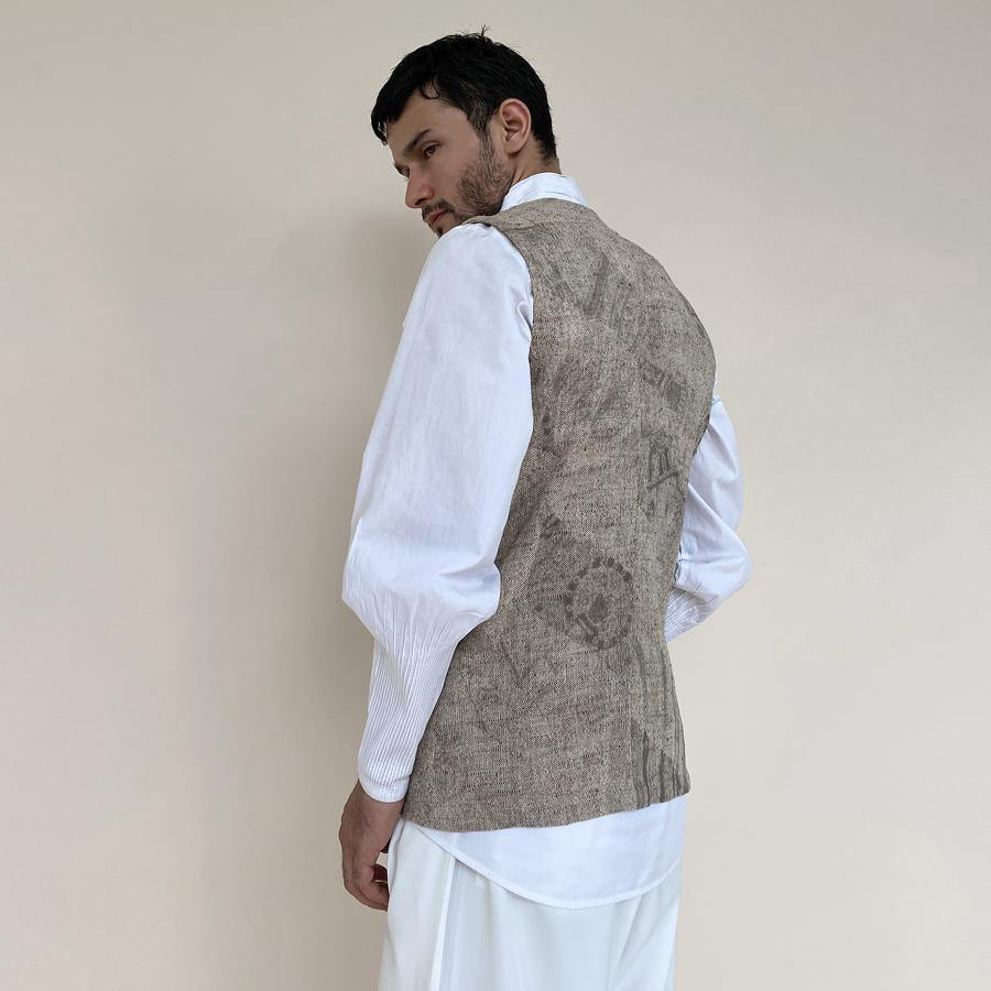 Load image into Gallery viewer, Handloom khadi bundi with single botton closure and shaped back. Cotton khadi shot texture bundi is ornamented with abstract distress print.  abhishek sharma, abhishekstudio