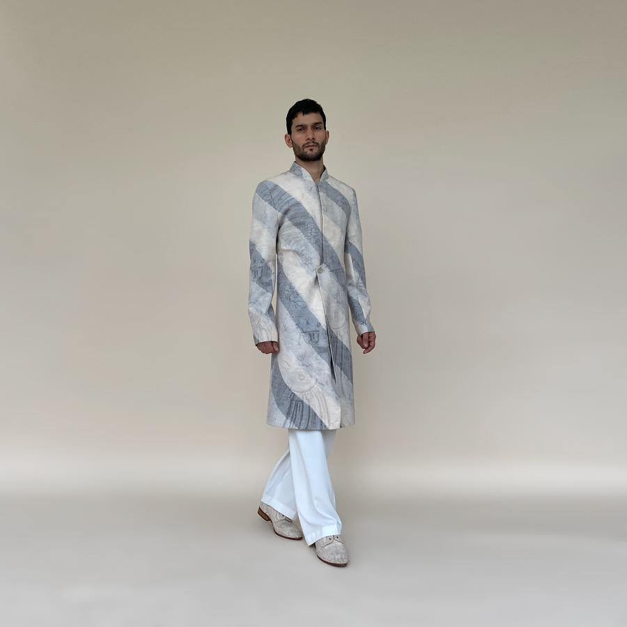 Short length single button closure sherwani with concealed placket. Cotton khadi sherwani is meticulously printed in abstract bias stripes.  abhisheksharma , abhishekstudio