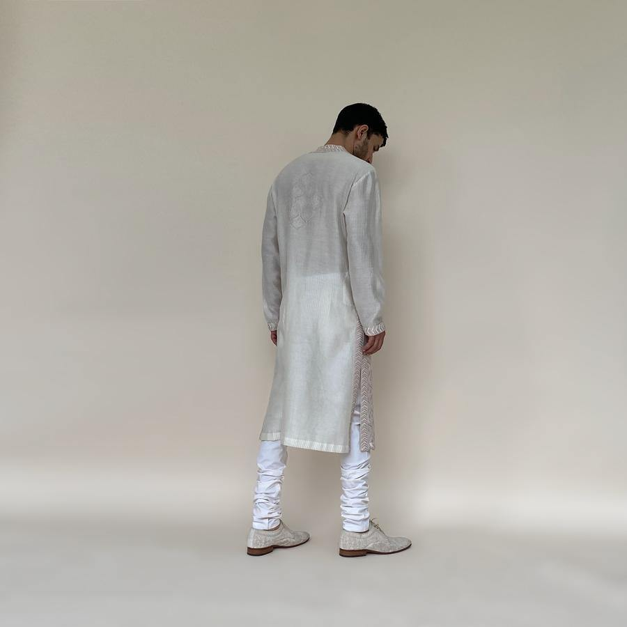 Monochrome silk thread embroidered kurta in chain stitch with textured sleeves and back. The intricate motifs and designs of traditional jamawar shawl are embellished on handloom chanderi truly gives a rich and distinctive look to the kurta with a hint of pearl embroidery. abhisheksharma , abhishekstudio