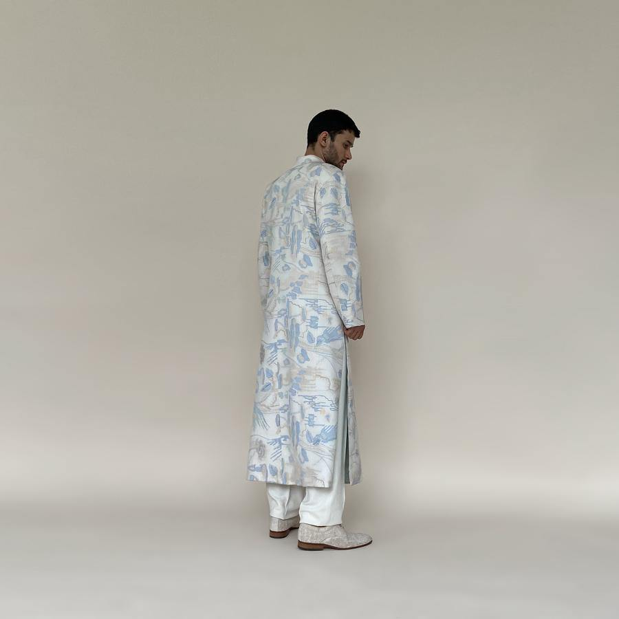 Classic mandarin collar sherwani with a buttoned closure. Heavyweight Matka silk sherwani features high slits and slightly flared panels for that extra ease while sitting or on the go. Sherwani is embellished in abstract impression pattern with multicolour silk thread.  Abhishek Sharma, abhishekstudio
