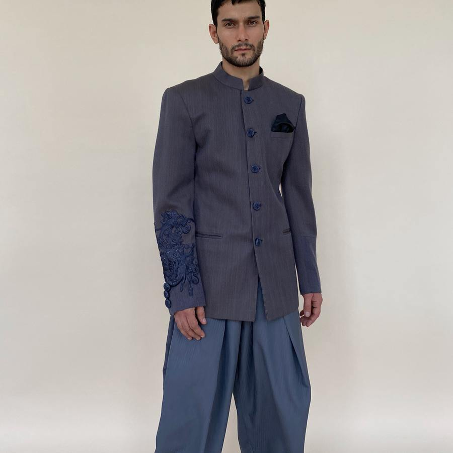 Classic bandgala in himalayan handloom wool. Grey shot texture wool bandgala features hand embroidered appliqué on sleeve and hand embroidered buttons.  abhisheksharma , abhishekstudio
