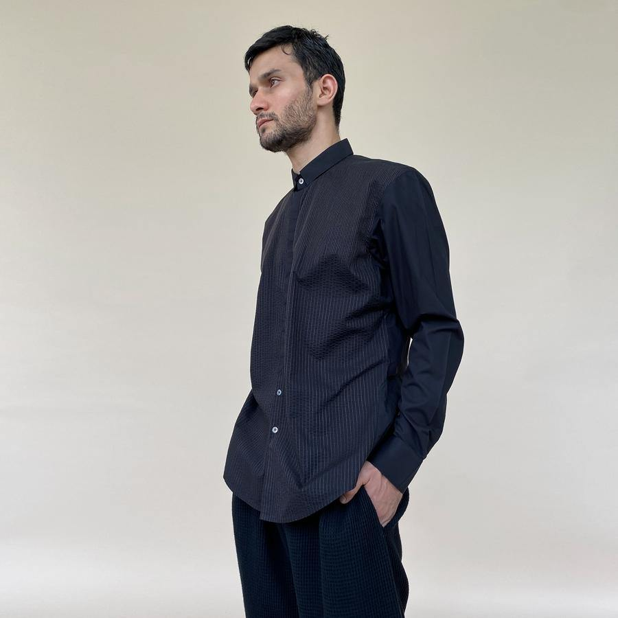 Fine textured shirt in super fine cotton with concealed placket. It features a minimalist square collar and shaped curve hem.  abhisheksharma , abhishekstudio