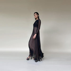 Chiffon long dress with textured and embroidered yoke and contrast lining. The dress has an elegant feel and is apt for dinners or cocktail relaxed evening. There is a play of easy drape and contrast lining to give a punch of colour and add glamour to the look.  Styling: style it with a diamond ring and studs and complete the look a sleek sling bag or a black crystallised clutch. you can also pair it up with black or nude heels. abhishekstudio, Abhishek Sharma