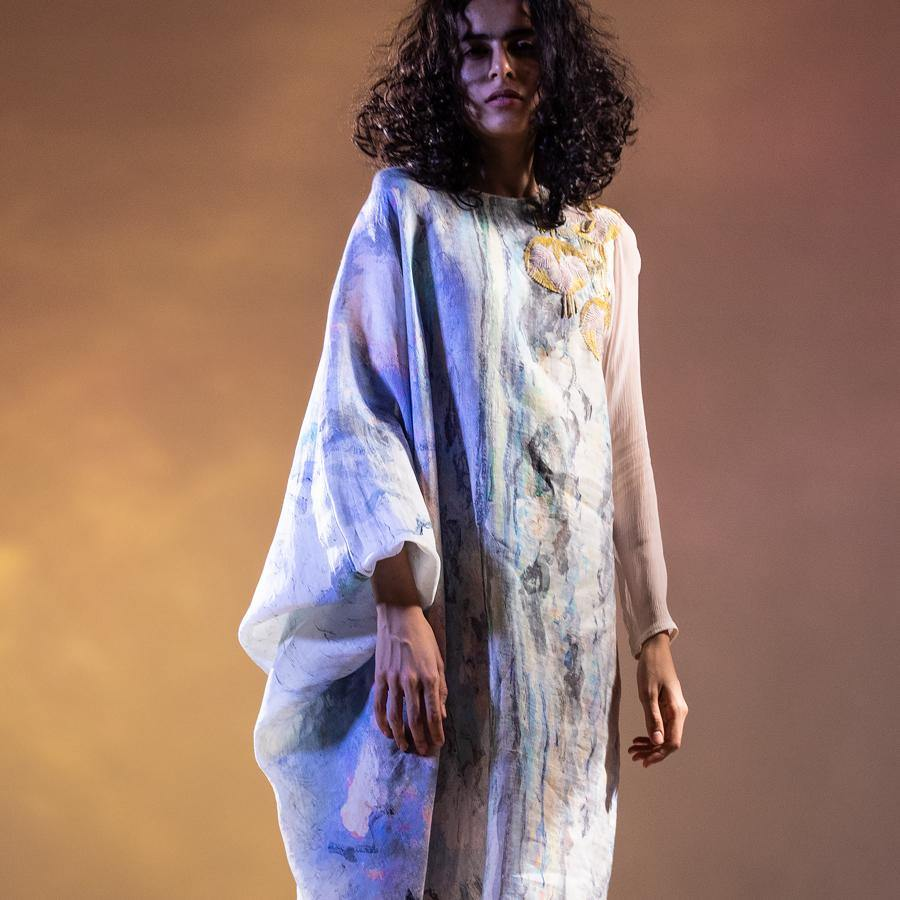 Impressionist printed draped tong tunic with rushed sleeve and placement embroidery. The tunic has a relaxed feel. There is fine resham and bugal bead embellishment along with Fluid form. Abhishekstudio, Abhishek Sharma