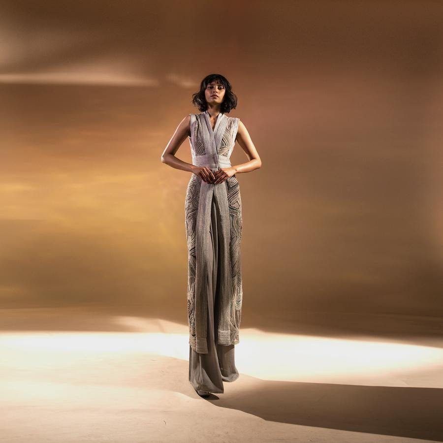Load image into Gallery viewer, Shaded chiffon couching textured long jacket teamed up with high waisted wide pants. The silhouette is sleek and graceful. The jacket is front overlap style with back shaped slit. There is graphic play of lines and colours with fine bead work embellishment. Elegant, understated yet high fashion. A perfect look for formal dinners or red carpet. The jacket has very subtle touch of shimmer that adds glamour to the whole look. Abhishekstudio, Abhishek Sharma