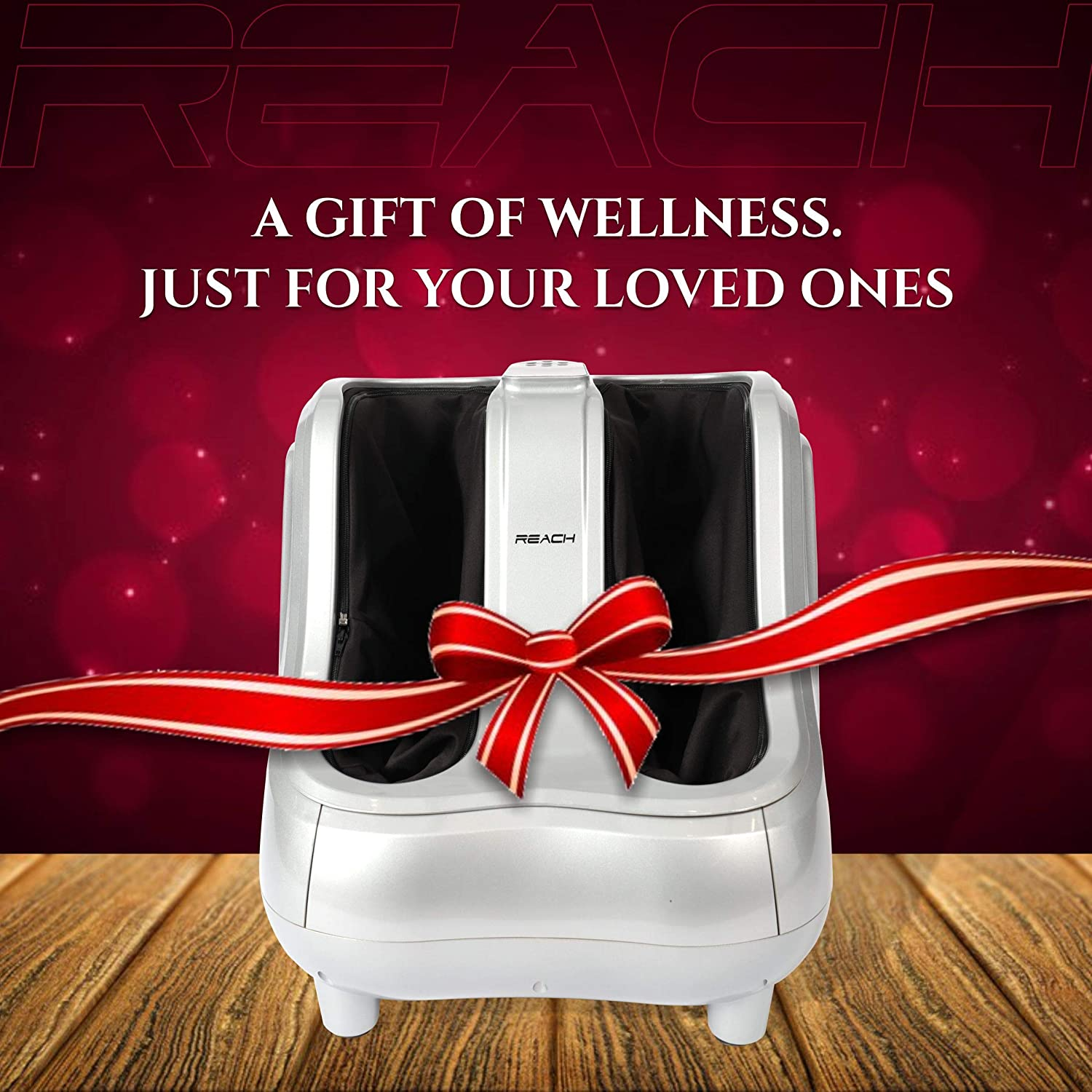 A Reach Bliss Leg Massager presented as a gift with a red ribbon tied across it.