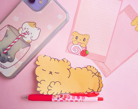osito a cute little teddy bear lying down with stationery