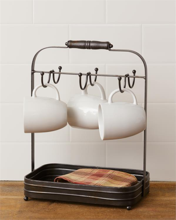 This is a galvanized farmhouse-style mug rack. There are six metal hooks to hang mugs, and a tray under it all for keep napkins in or for other shallow storage or decor options.