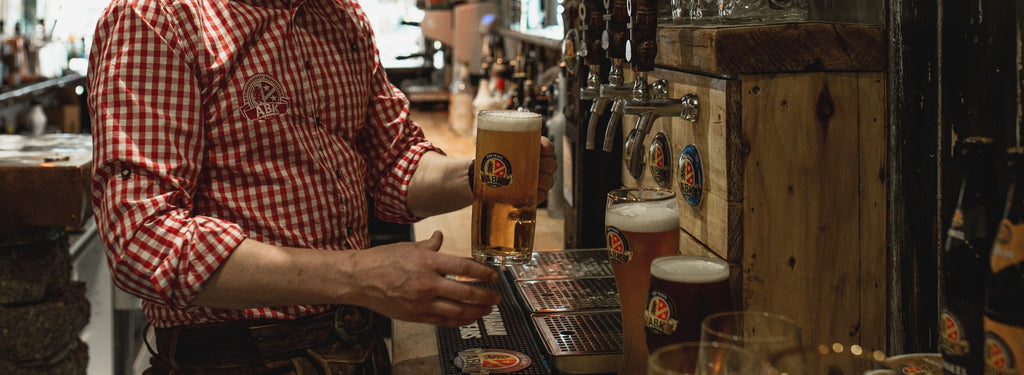 Bartender pour an ABK edel a type of export lager