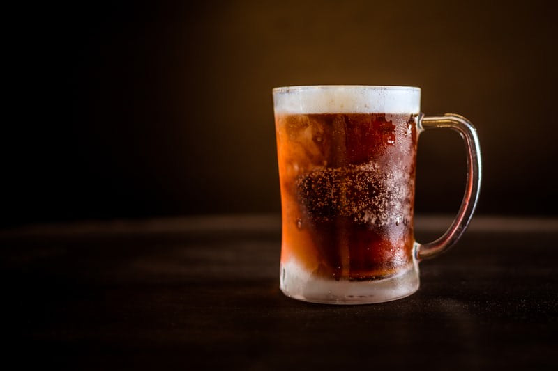 A stein of stauncbier a copper colored german lager