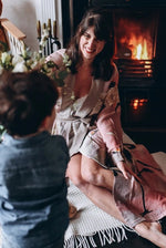 Load image into Gallery viewer, One Hundred Stars Stork Dressing Gown - Pink on a mum by woodburner