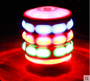 Luminous gyro spinning with beautiful flashing colorful lights