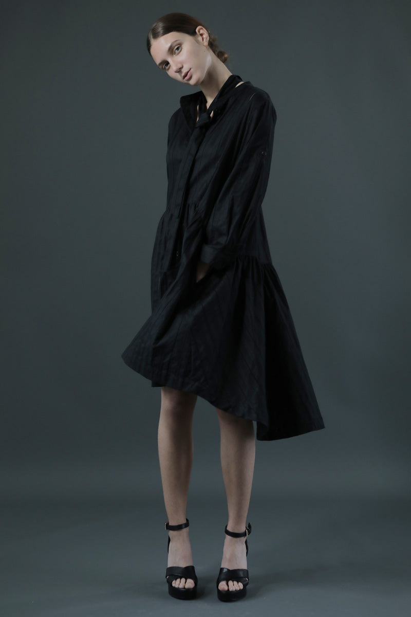 Aqua & Rock black Italia smock dress sustainably sourced fabrics with a drop hem and skater skirt