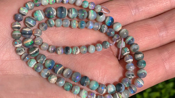 Lightning Ridge Black Opal bead strand