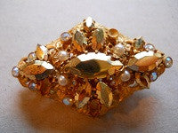 Vintage gold colored filligree brooch