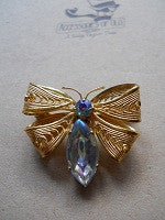 Vintage butterfly style brooch with rhinestone and filligree wings