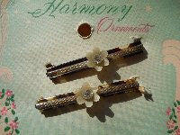 Mother of pearl pair of vintage clips