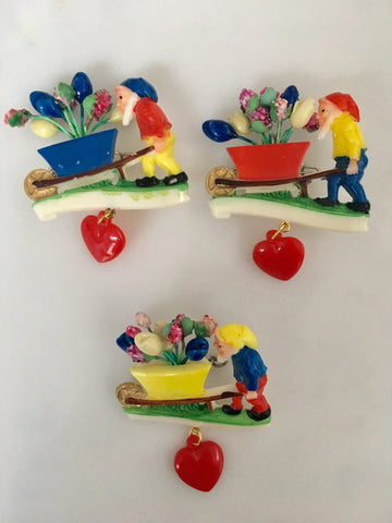 Novelty plastic gnome and wheelbarrow vintage brooch