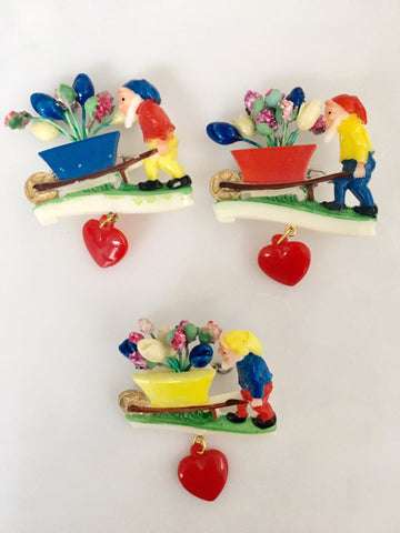 Vintage 1960's dwarf and wheelbarrow brooches