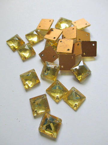 Square gold foiled two hole crystal Austrian flatbacks. Measuring 1cm. Sold by the dozen. $3.00 per dozen.