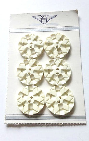 White carved casein buttons