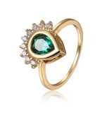 Beautiful timeless pear shape Chrome Diopside and round White Sapphire ring in yellow gold.