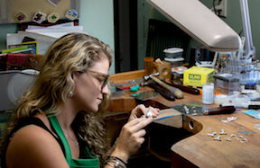 hali maclaren working at the hkm jewelry studio bench