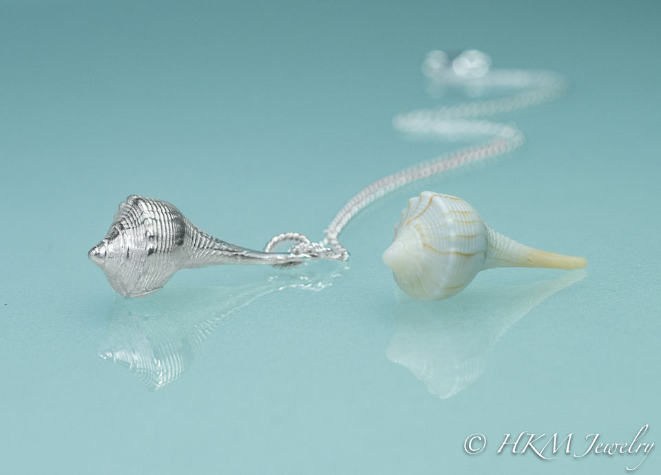 custom cast lightning whelk necklace in sterling silver from a clients favorite shell
