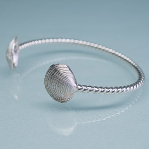 side view of clam cuff by hkm jewelry