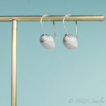 Load image into Gallery viewer, side view of the ark clam seashell dangle earrings by hkm jewelry in sterling silver