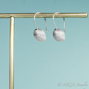 side view of the ark clam seashell dangle earrings by hkm jewelry in sterling silver
