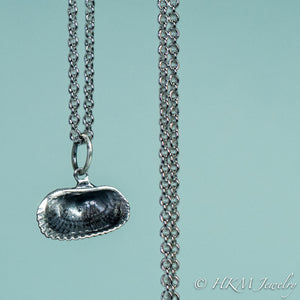 back close up view of ark clam shell necklace in oxidized silver by hkm jewelry