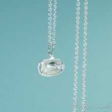 Load image into Gallery viewer, back close up view of ark clam shell necklace in polished silver by hkm jewelry