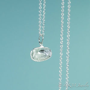 back close up view of ark clam shell necklace in polished silver by hkm jewelry