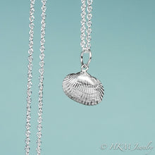 Load image into Gallery viewer, front close up view of ark clam shell necklace in polished silver by hkm jewelry