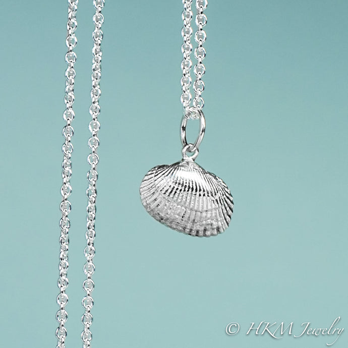 front close up view of ark clam shell necklace in polished silver by hkm jewelry