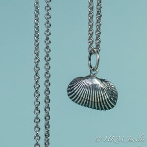 front close up view of ark clam shell necklace in oxidized silver by hkm jewelry
