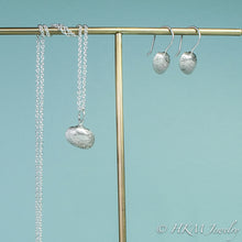 Load image into Gallery viewer, side view of ark clam seashell drop earrings in silver with matching ark clam necklace