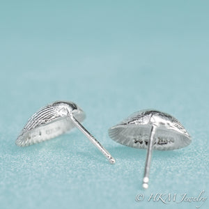 close up view of the back of the ark clam shell stud earrings in polished silver by hkm jewelry