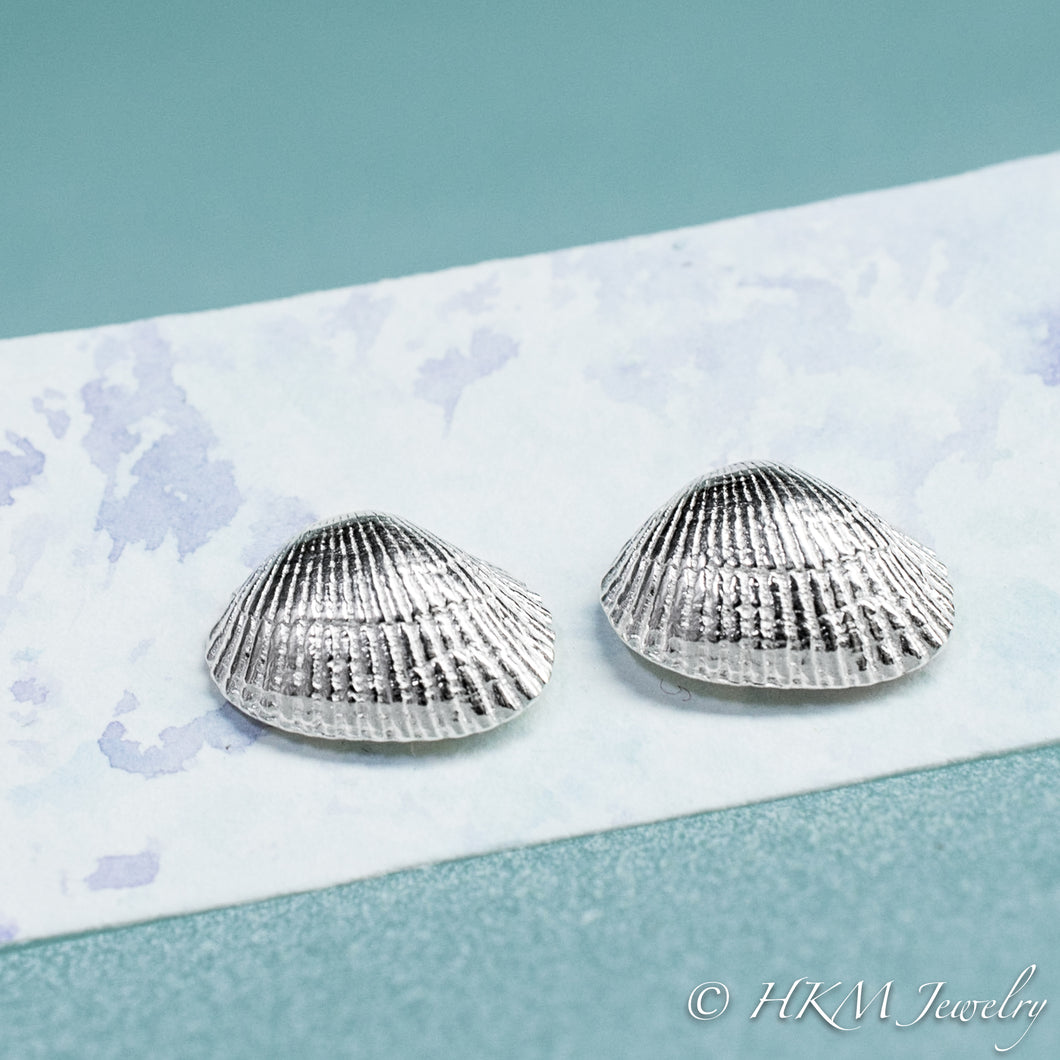 front close up view of ark clam shell stud earrings in polished silver by hkm jewelry