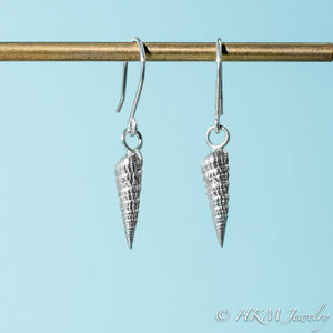 close up side and front view of auger snail shell dangle earrings in polished silver by hkm jewelry