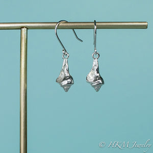 side and front view of the baby knobbed whelk dangle earrings in sterling by hkm jewelry