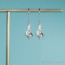 Load image into Gallery viewer, close up front view of the baby knobbed whelk dangle earrings in sterling by hkm jewelry