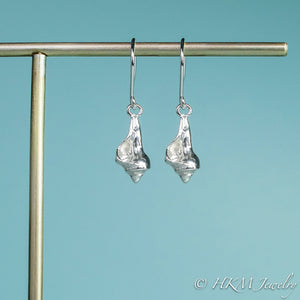 close up front view of the baby knobbed whelk dangle earrings in sterling by hkm jewelry