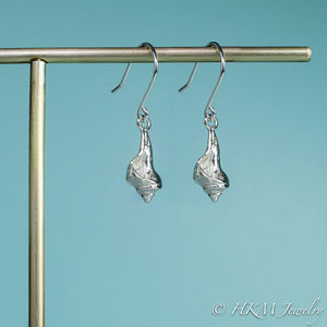 close up side view of the baby knobbed whelk dangle earrings in sterling by hkm jewelry