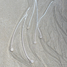 Load image into Gallery viewer, assorted raw cape may diamond necklaces by hkm jewelry laying in sand
