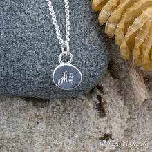 Load image into Gallery viewer, close up back view of makers mark and .925 stamp onmedium size raw cape may diamond necklace in a sterling silver bezel by hkm jewelry